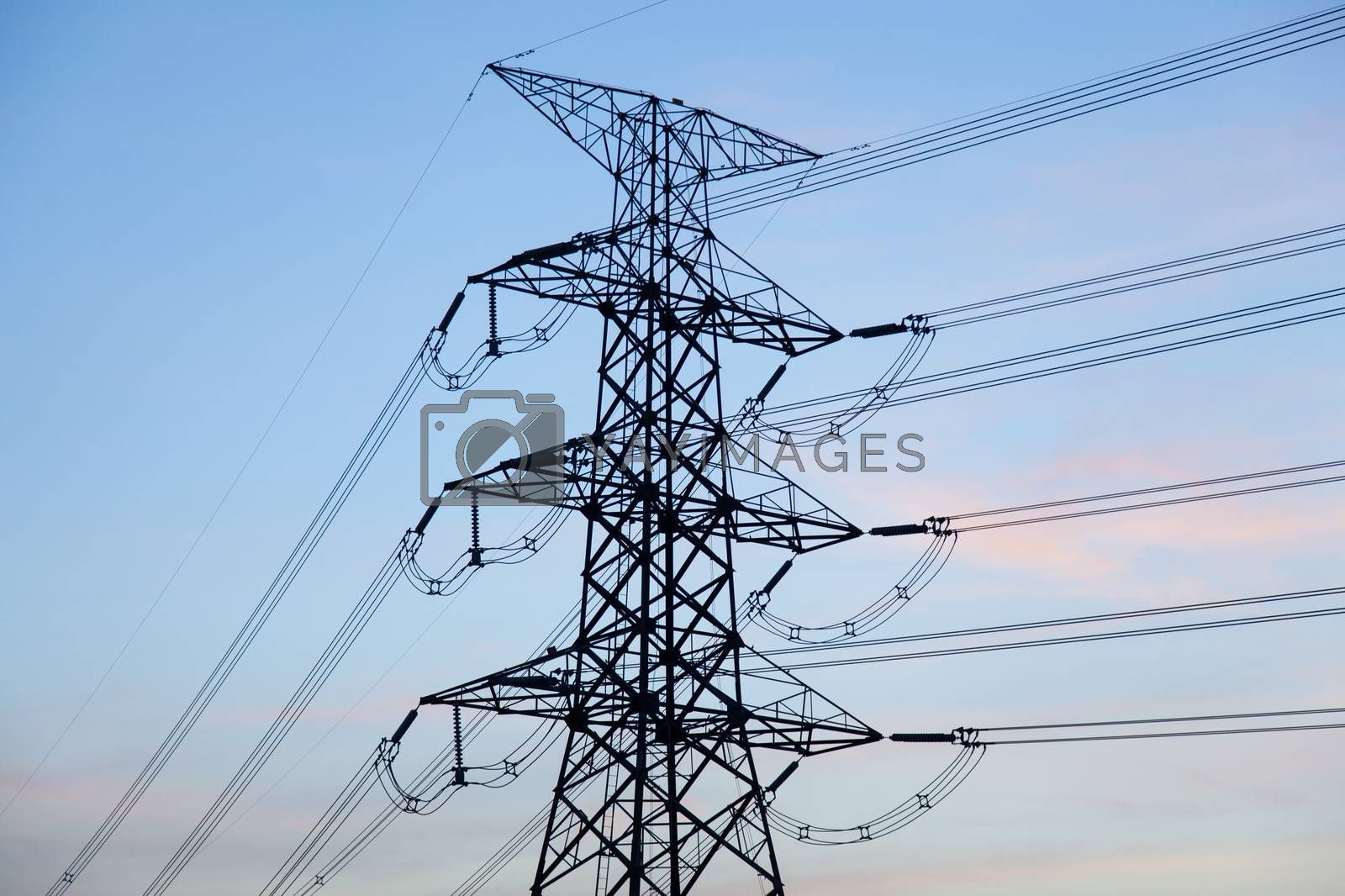 High voltage towers. High voltage power electric transmission towers of a power plant to the substation.