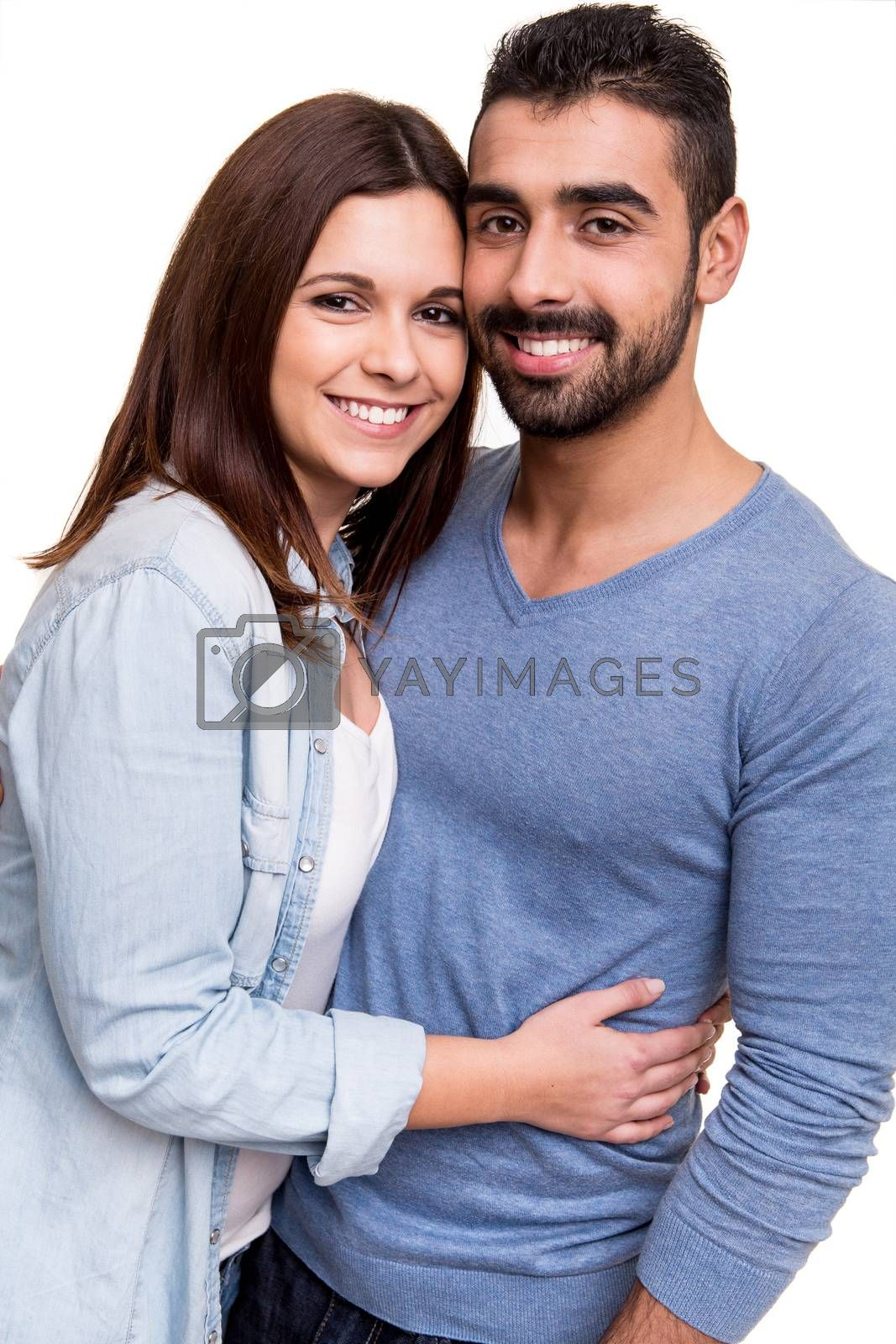 Young love couple hugging over white background
