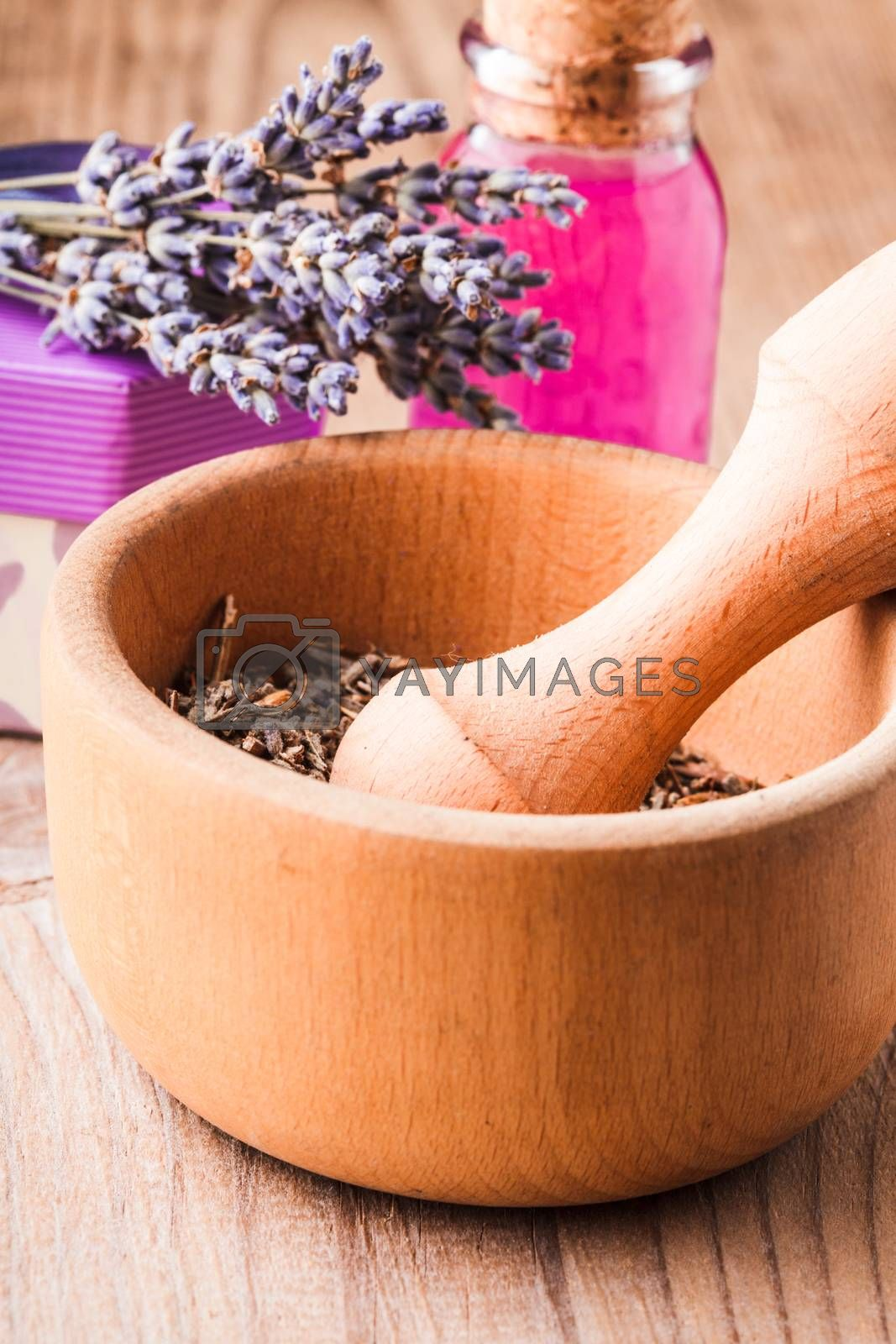 Dry lavender bunch and wooden mortar, preparation