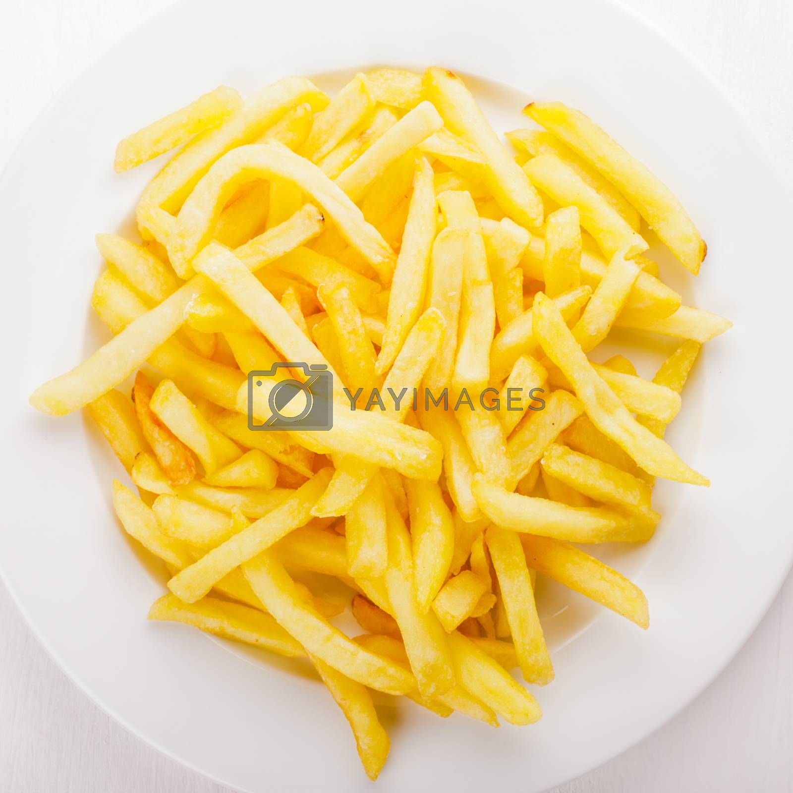 Fried potato on a white plate on the table