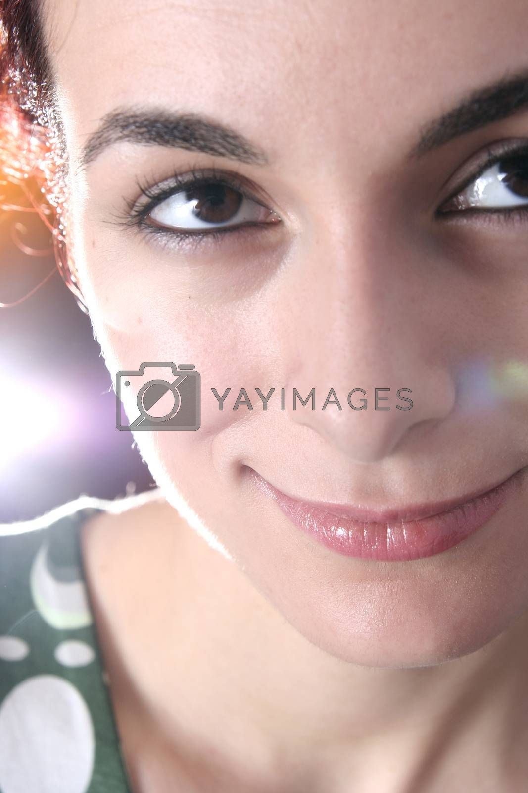 Beautiful woman face  with light effects