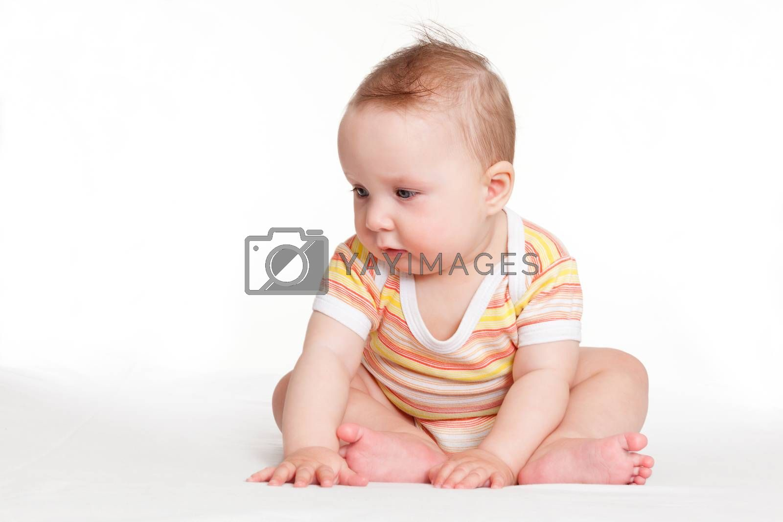 Cute small baby sitting and looking isolated on white background. Happy tiny adorable newborn baby.