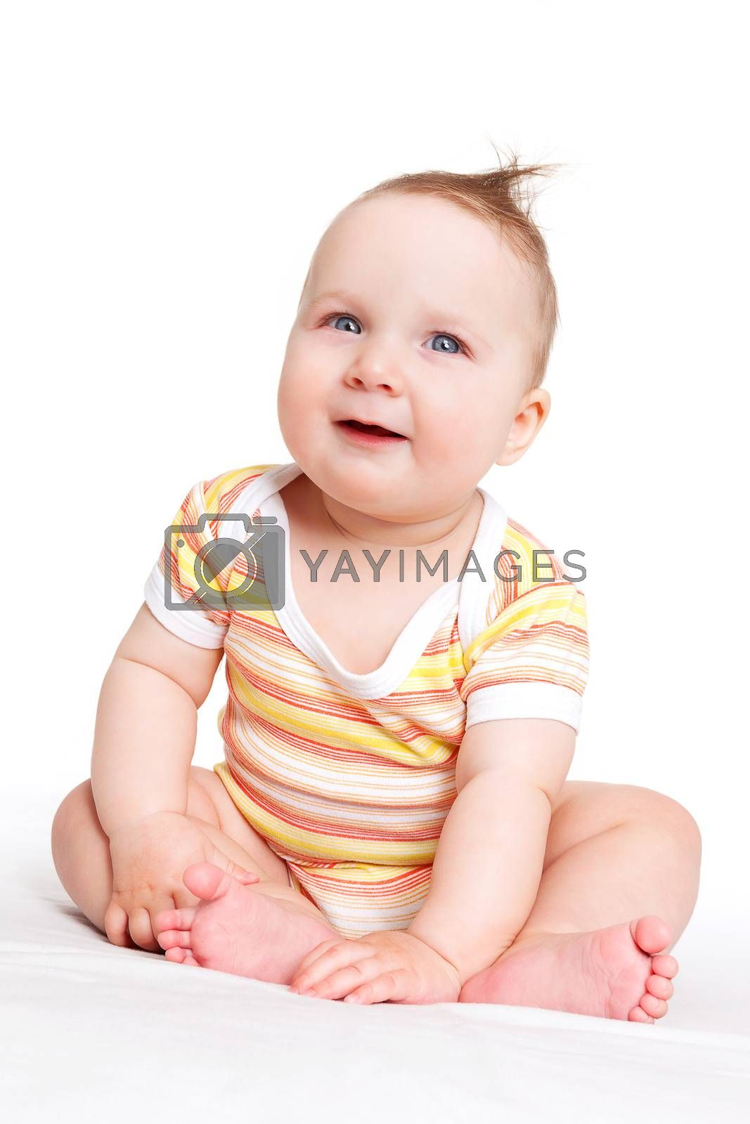 Cute adorable baby girl sitting, smiling and looking. Baby girl sitting isolated on white background. Happy family concept.