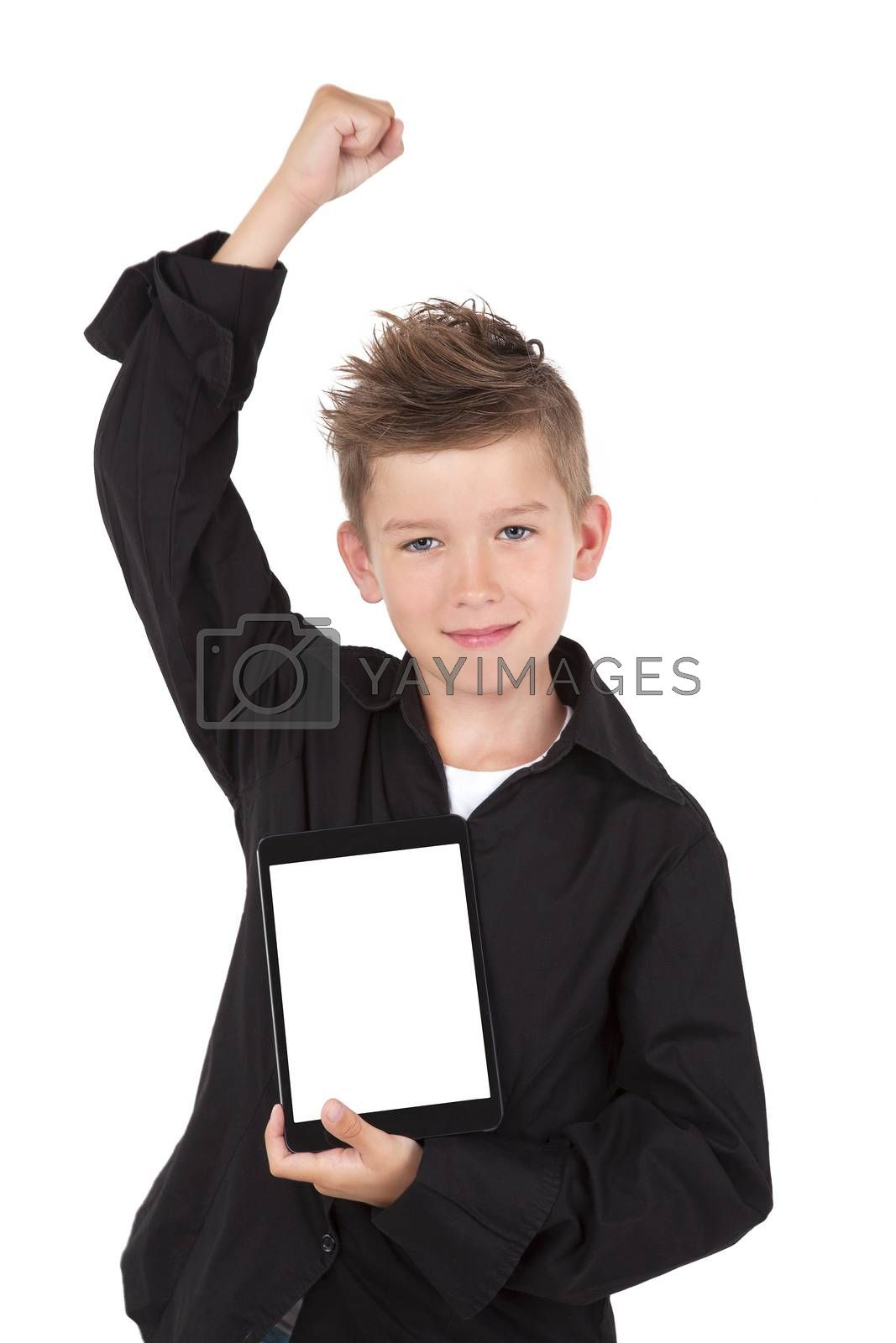Successful boy with hand up holding tablet with white screen facing camera isolated on white background.