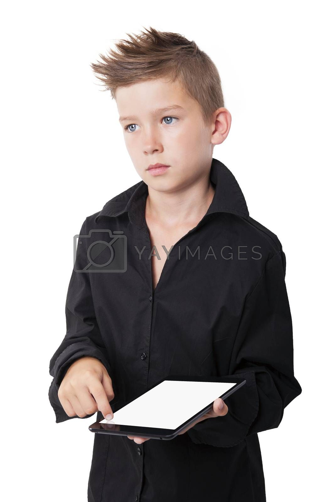 Charming boy holding and touching tablet screen with finger isolated on white background.