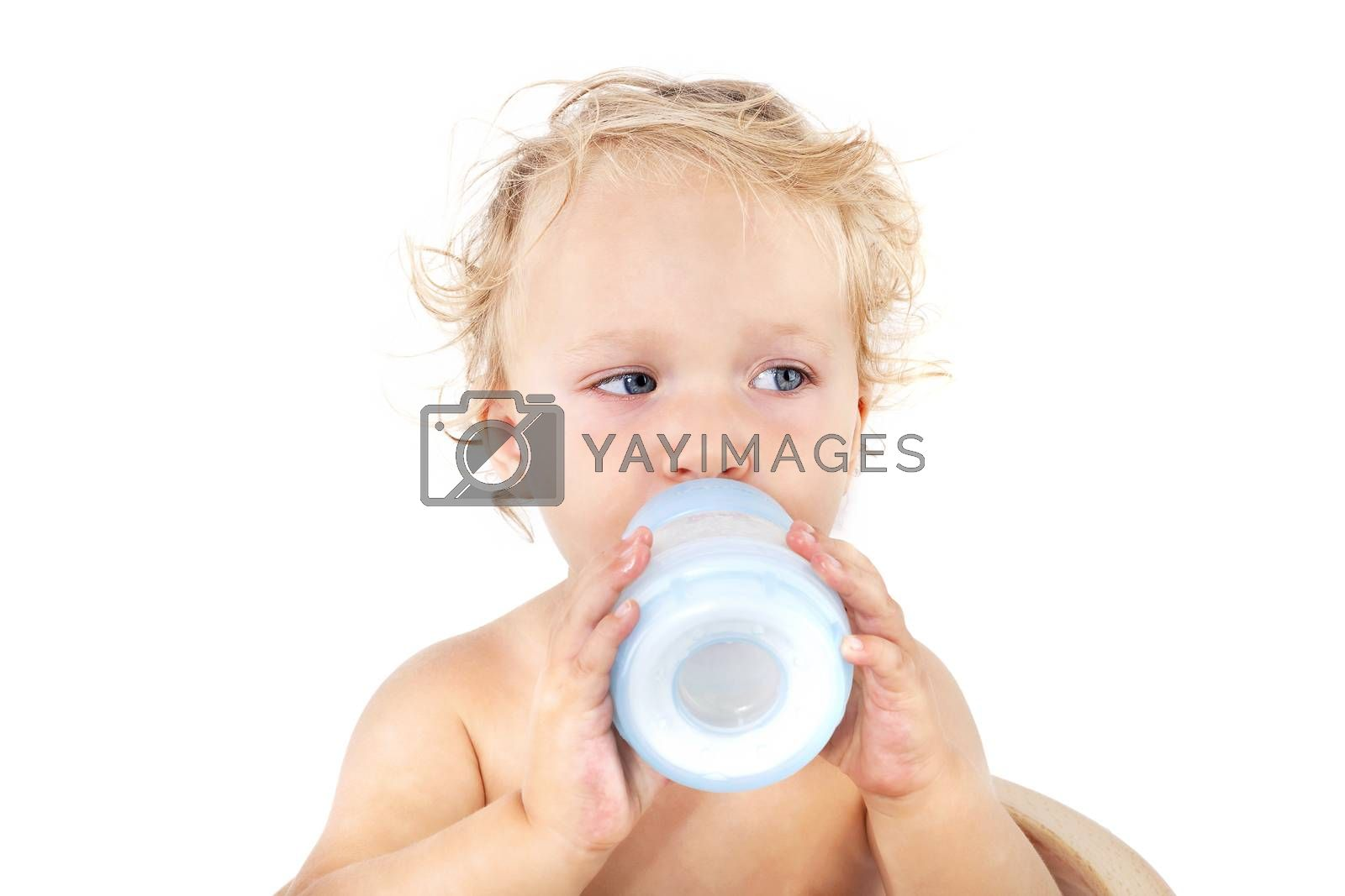 Cute blonde curly baby girl drinking milk from baby battle isolated on white background. Baby, milk and eating concept with copy space.