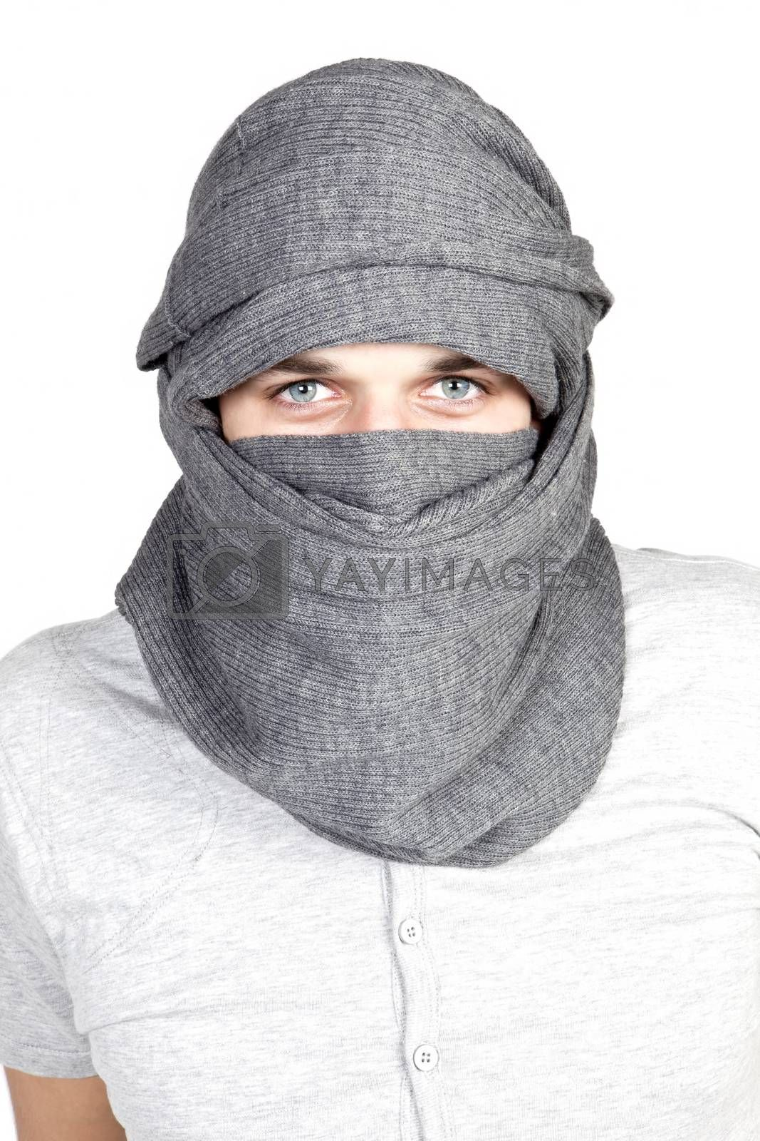 Portrait of young sexy guy with turban and blue eyes looking into the camera isolated. Tuareg concept.