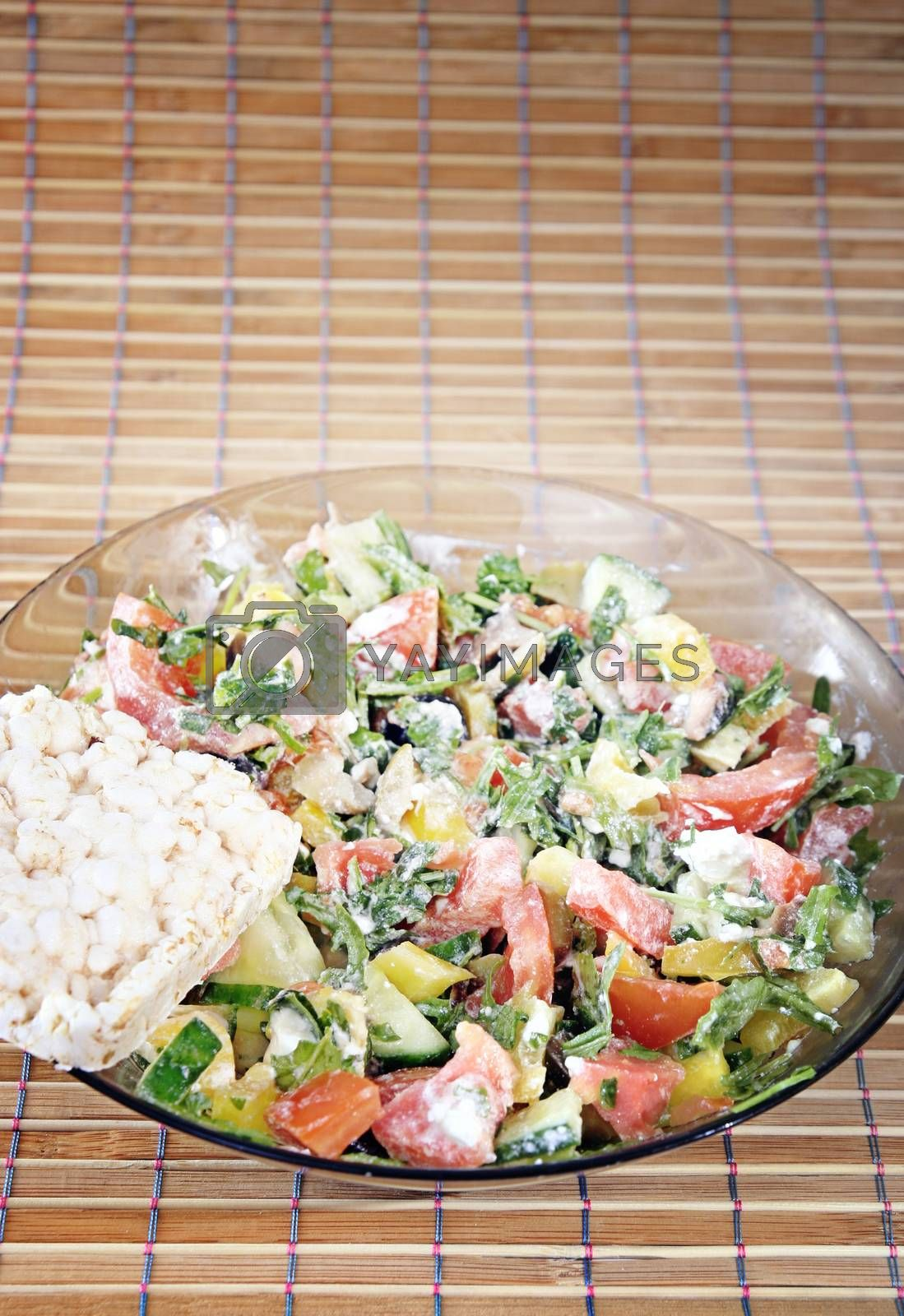 Healthy salad with vegetables and cheese