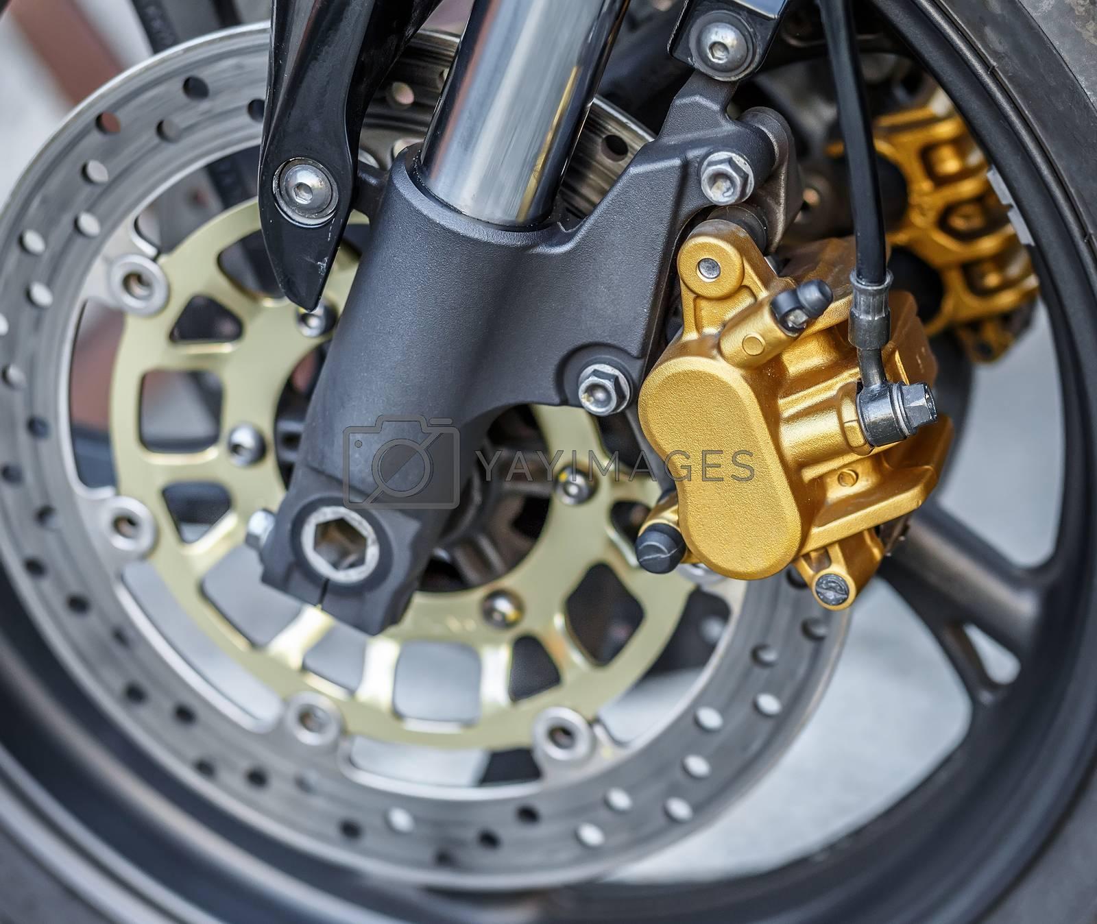 Royalty free image of motorcycle wheel brake background in motorbike, motorcycle wheel by artush