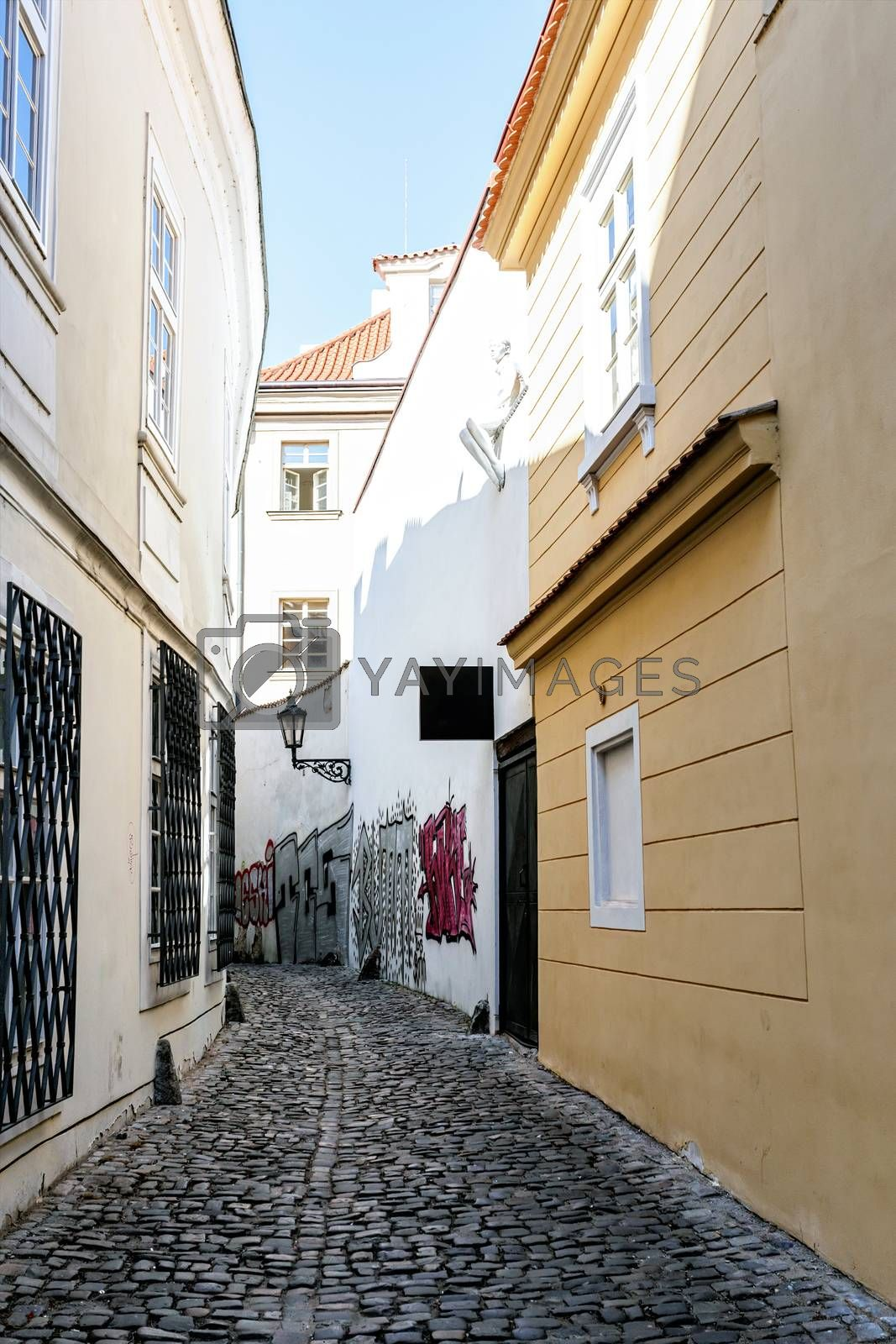 Royalty free image of A small narrow street in the old town area of Prague by artush