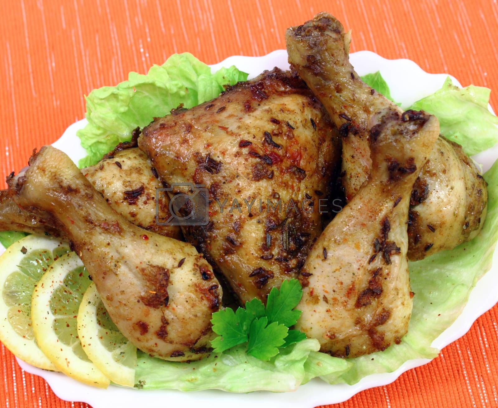 Royalty free image of Roasted chicken drumsticks by openas