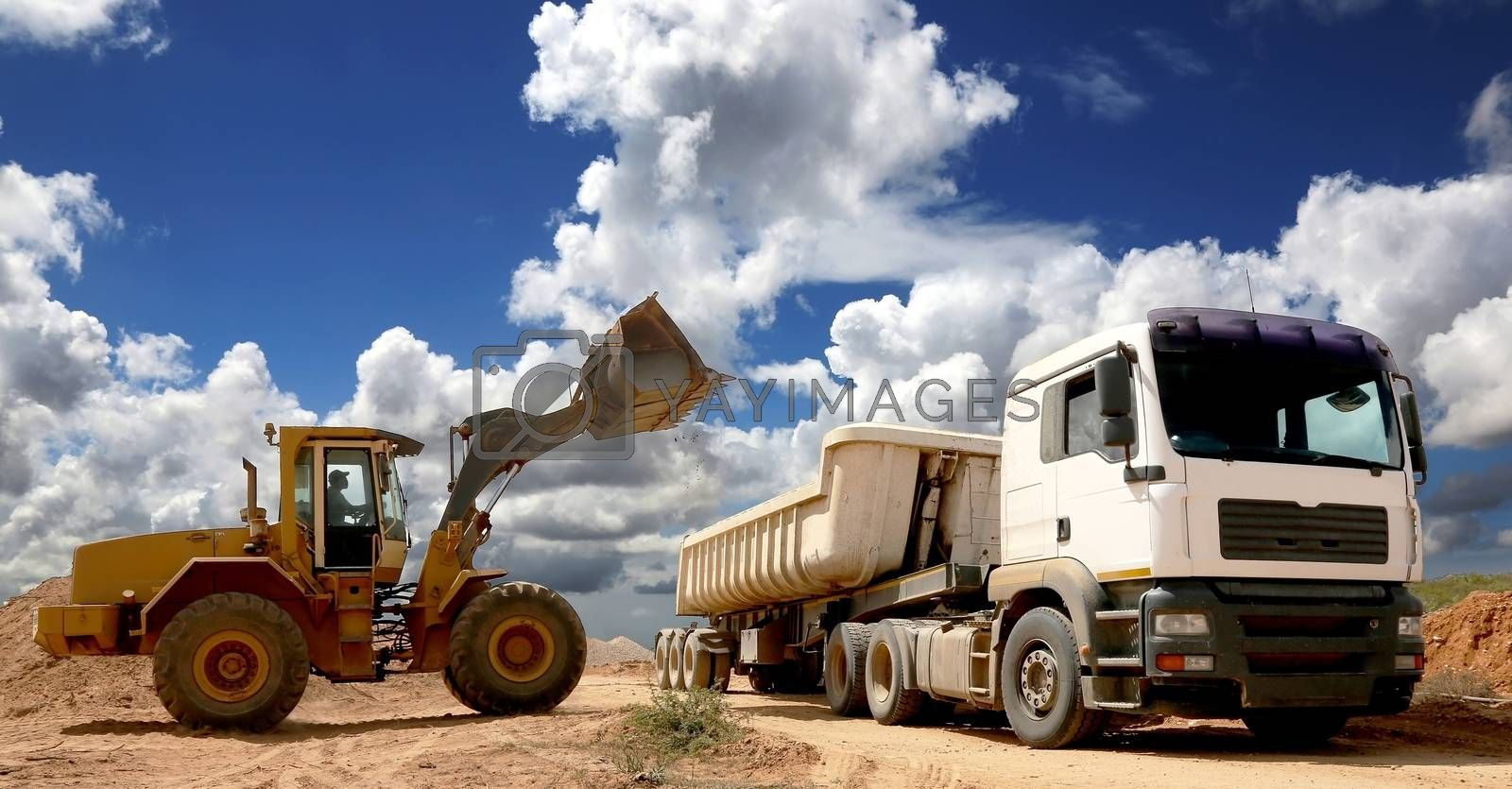 Royalty free image of Front End Loader Filling Truck by fouroaks