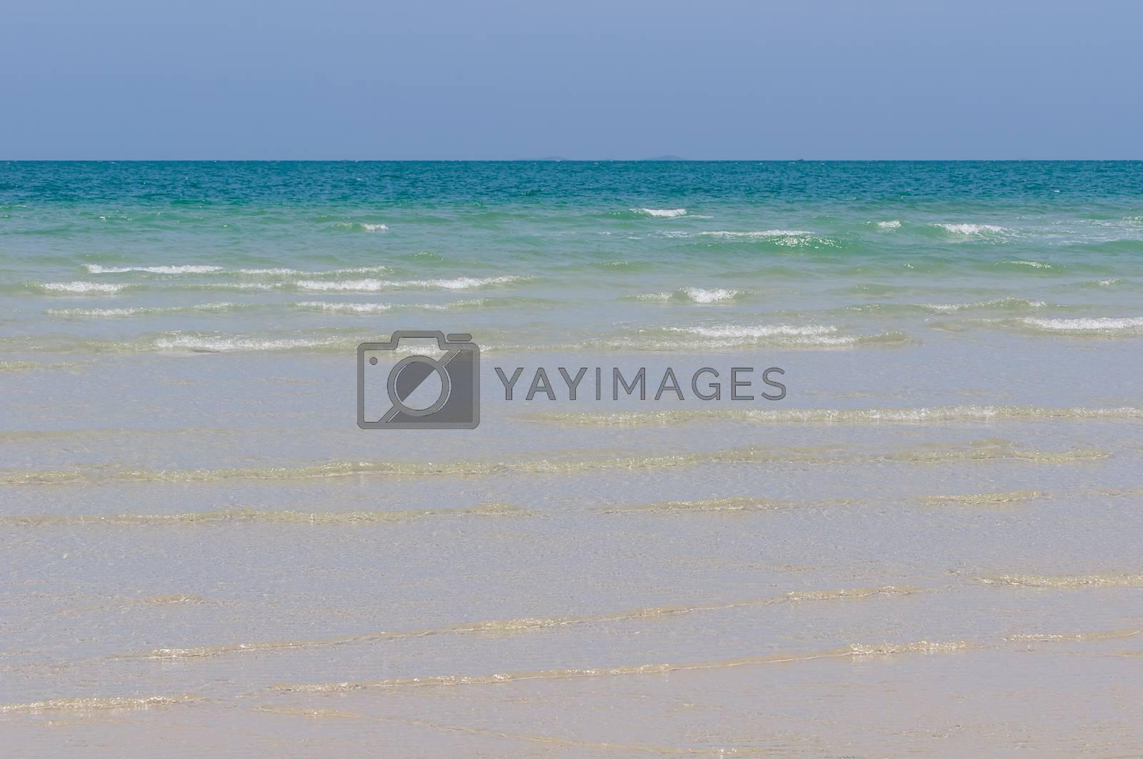 Royalty free image of Sea with waves sandy coastline by Sorapop