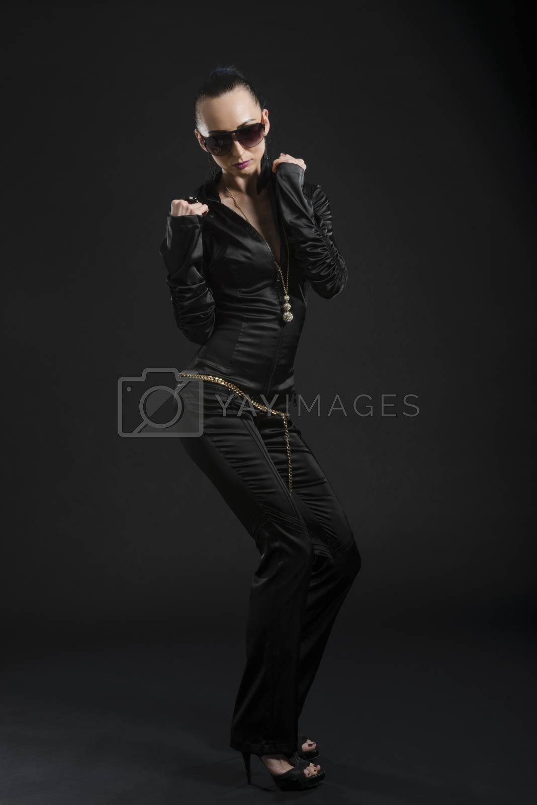 Royalty free image of Pretty Caucasian woman in black leather catsuit by icenando