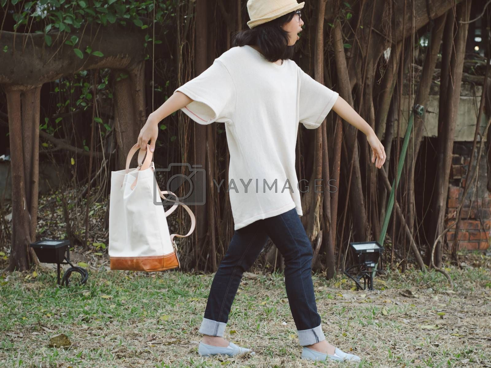 Royalty free image of Funny woman with a canvas bag, Outdoor portrait by siraanamwong