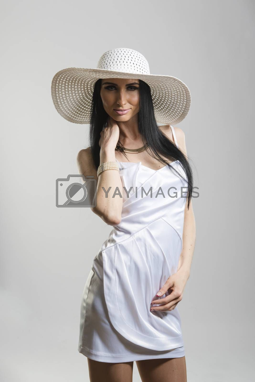 Royalty free image of Pretty Caucasian woman in white dress by icenando