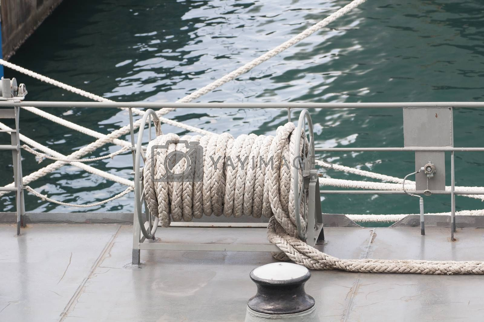 Royalty free image of roll of rope at the warship by Sorapop