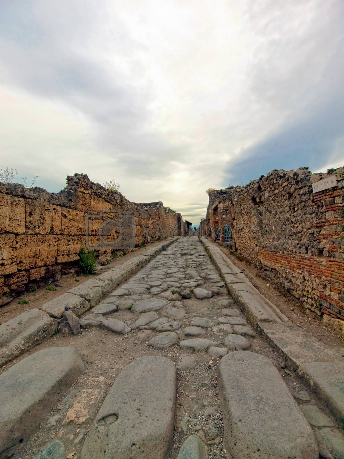 Royalty free image of Street in Pompeii with a stone walkway for pedestrians by johan10