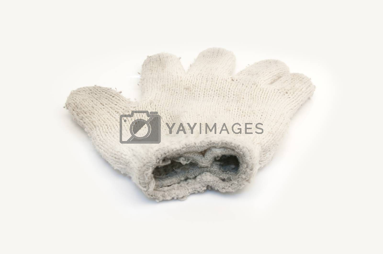 Royalty free image of Knitted woolen white gloves by Sorapop