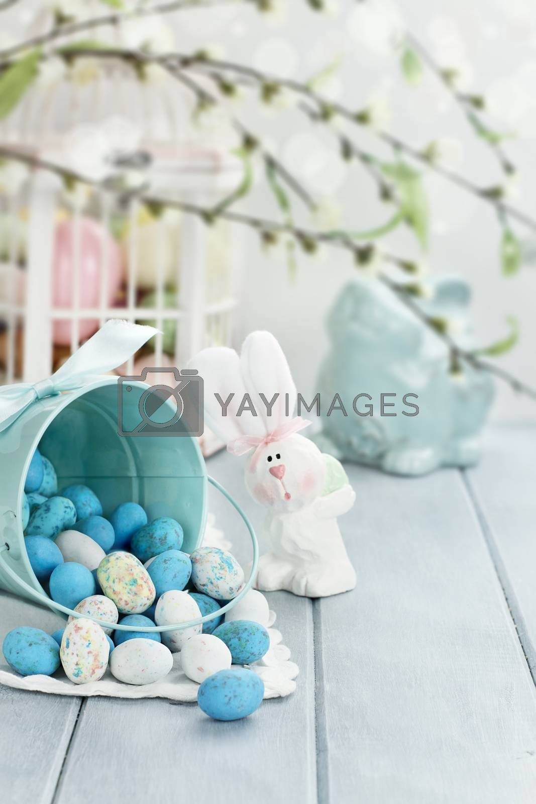 Royalty free image of Basket of Easter Candy Eggs by StephanieFrey