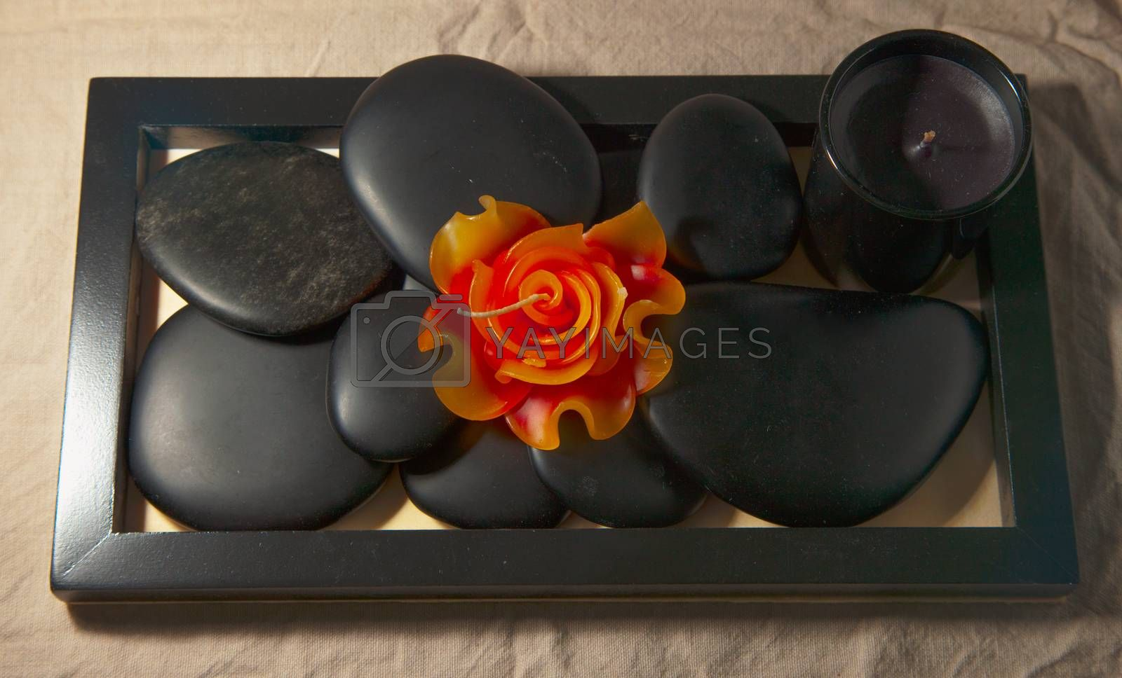Royalty free image of Candles and stones by Koufax73