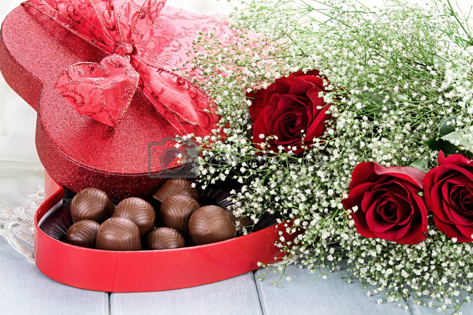Royalty free image of Box of Chocolates and Beauitful Roses by StephanieFrey