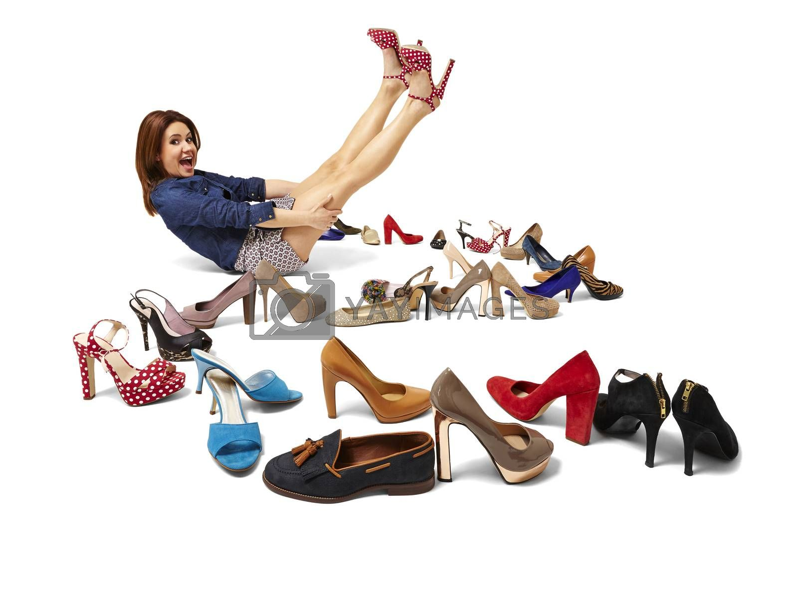 Royalty free image of Fashionable woman and great selection of shoes by filipw