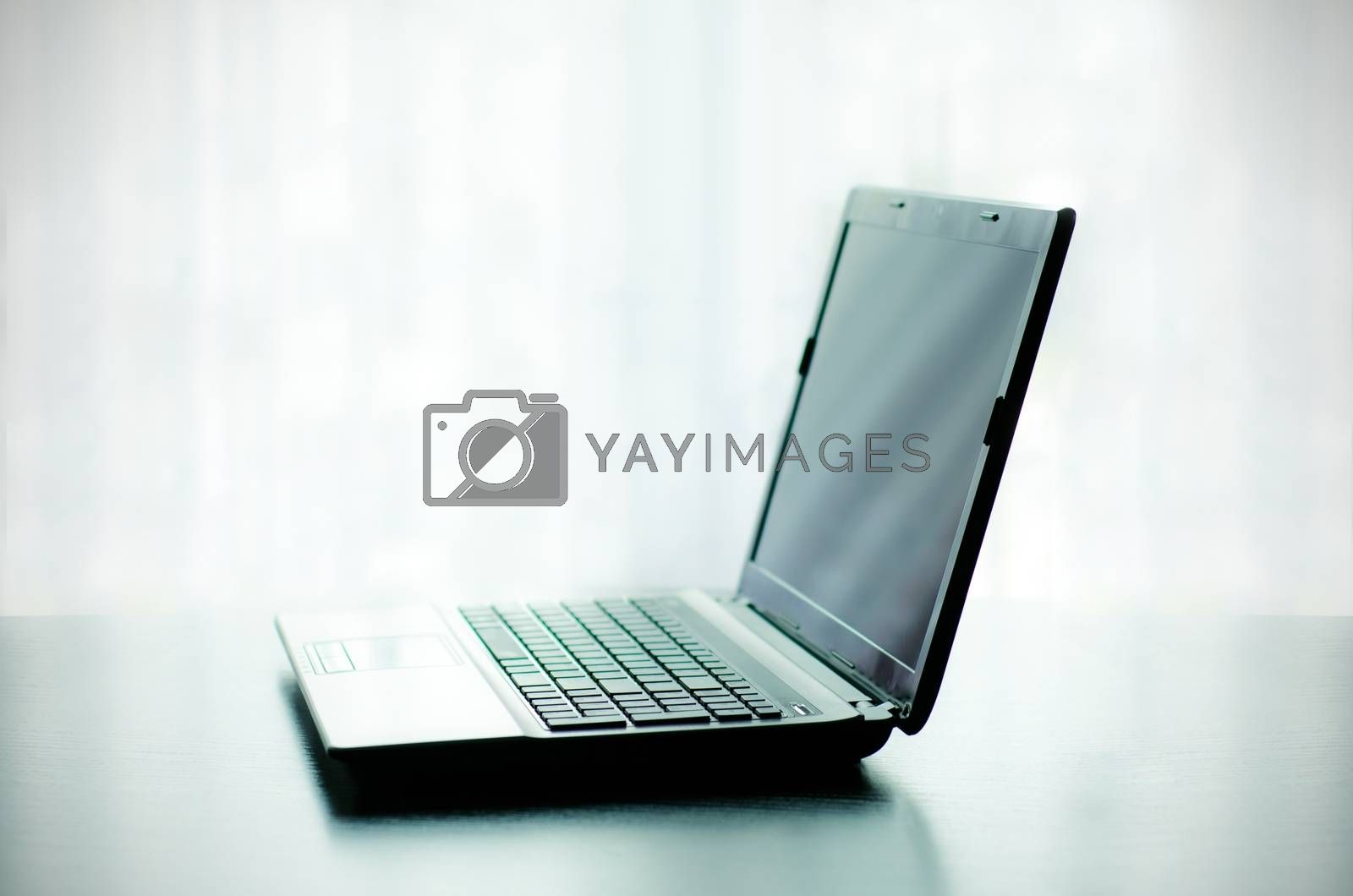 Royalty free image of Modern laptop on desk by simpson33