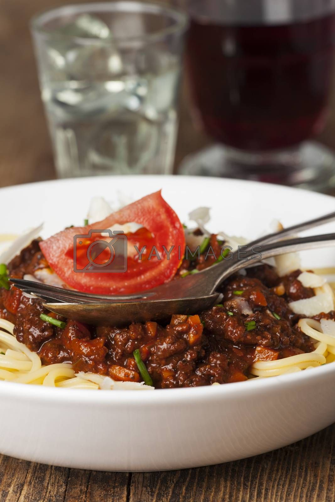 Royalty free image of spaghetti bolognese and cheese  by bernjuer
