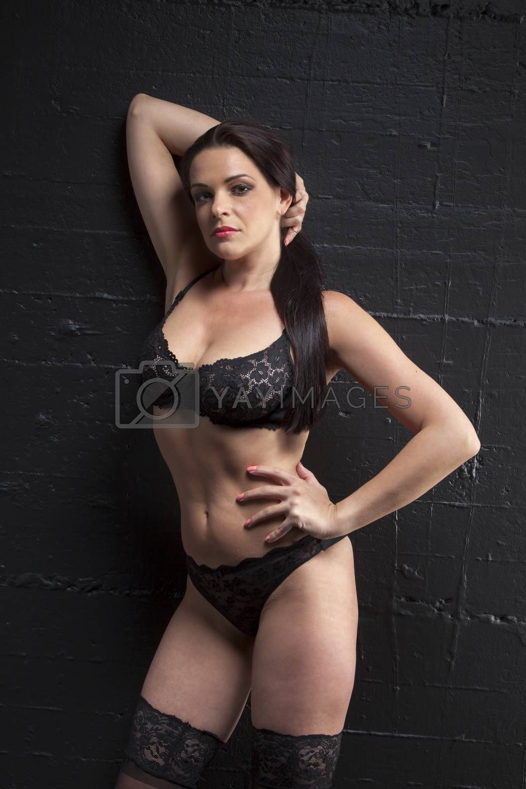 Royalty free image of woman in underwear on a wall by bernjuer