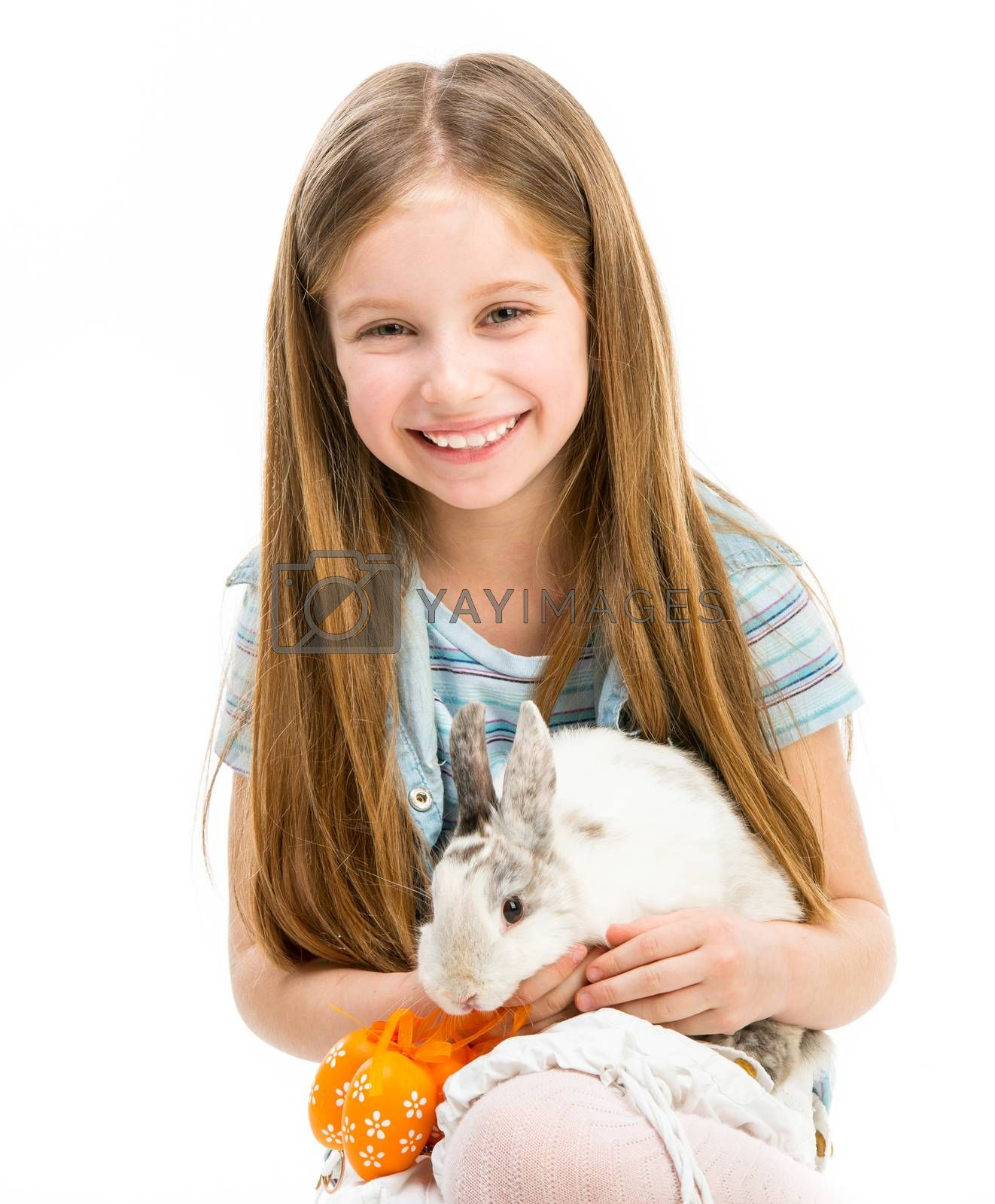 Royalty free image of little girl with rabbit by GekaSkr