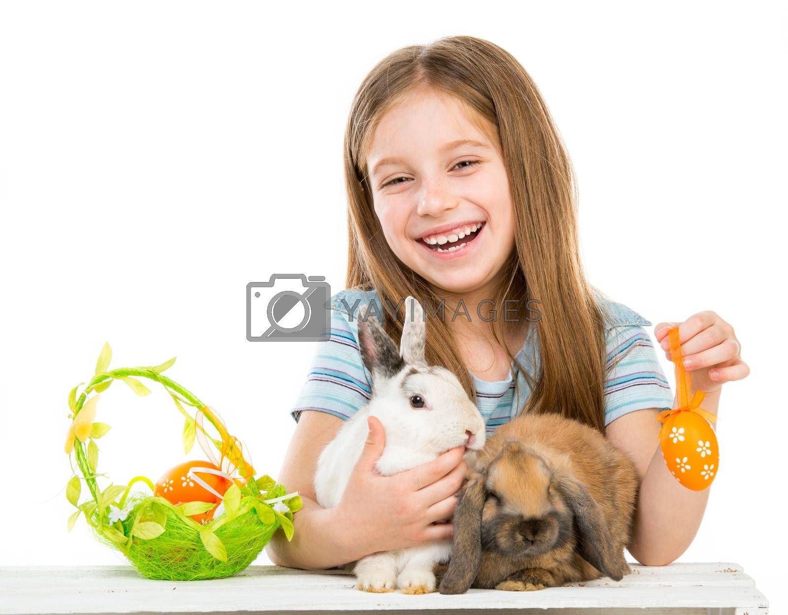 Royalty free image of little girl with rabbits by GekaSkr