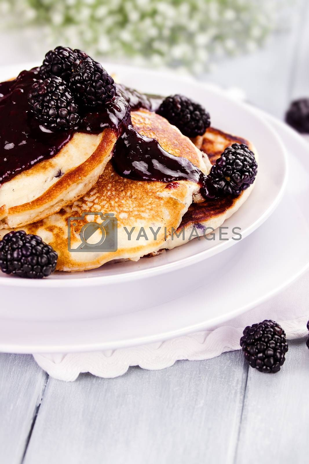 Royalty free image of Pancakes and Blackberry Sauce by StephanieFrey
