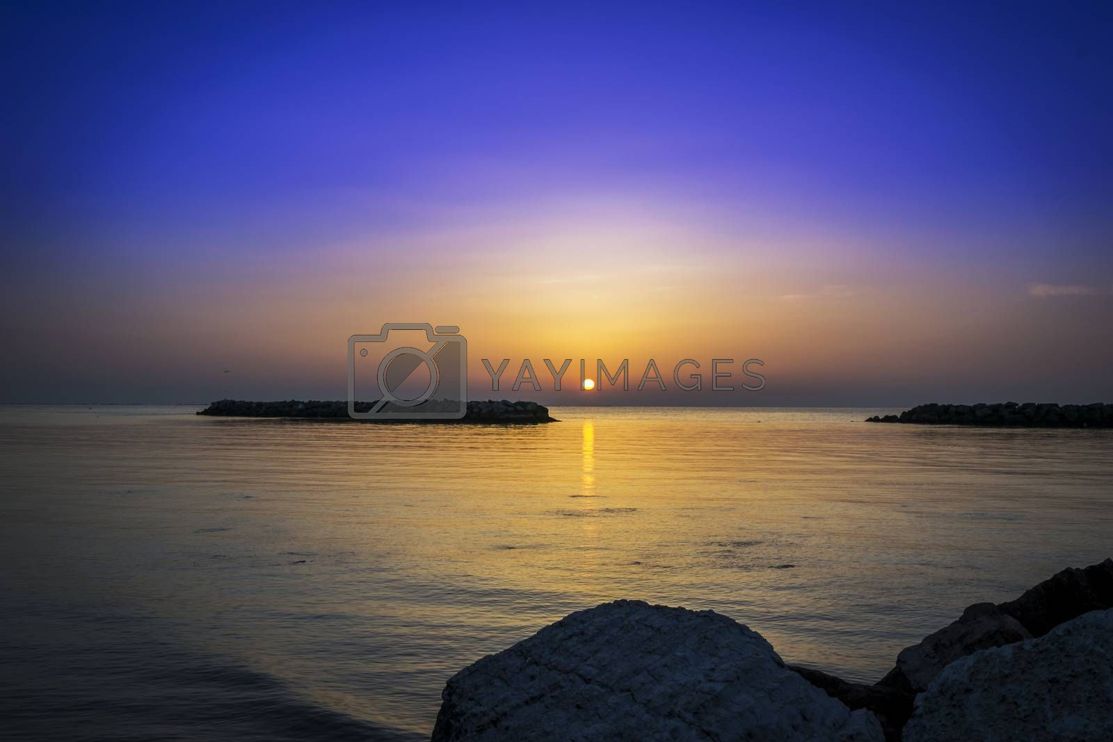 Royalty free image of Beautiful sunrise by the sea by enrico.lapponi