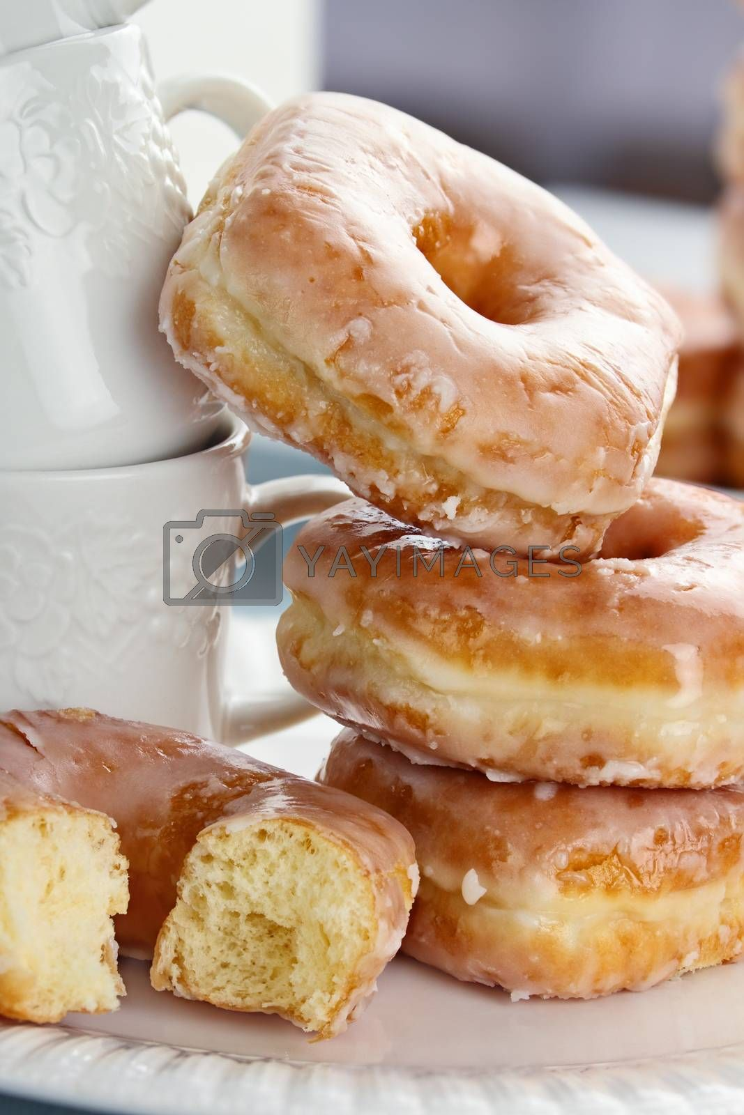 Royalty free image of Stacked Donuts and Cups by StephanieFrey
