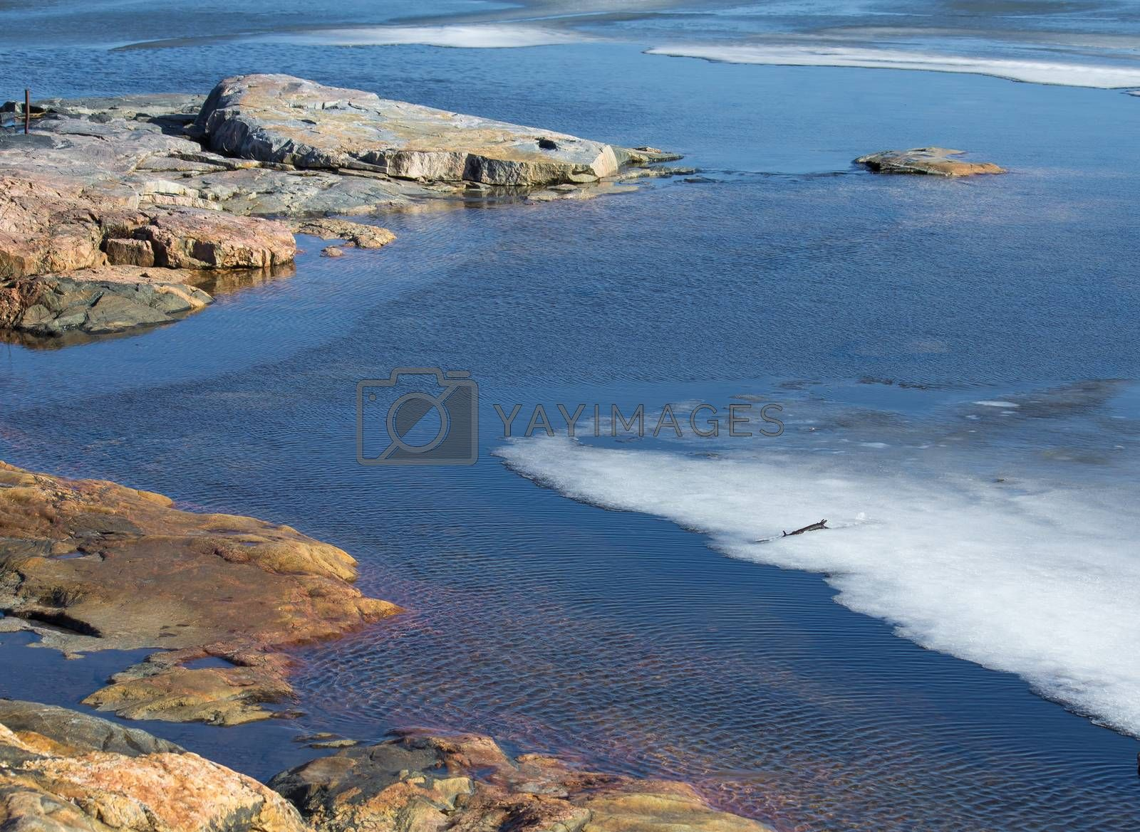 Royalty free image of Rocky ocean shore with ice by Alexanderphoto