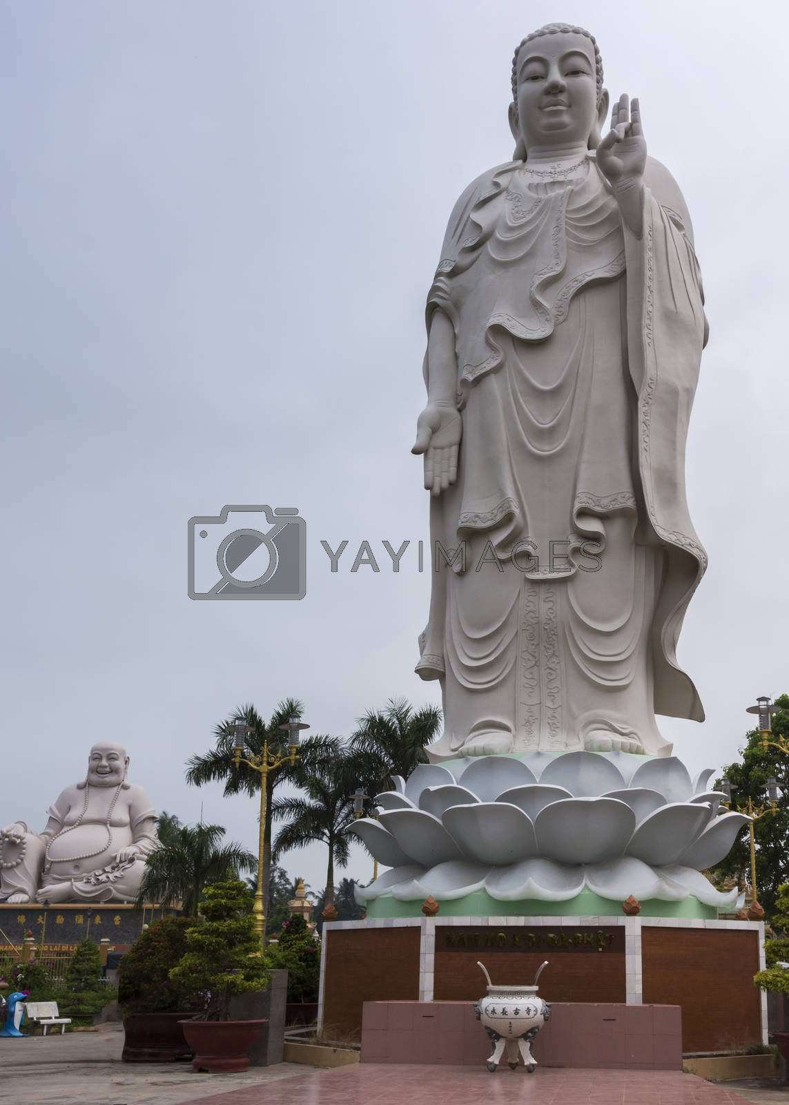 Royalty free image of Combination shot of Amitabha statue with Buddha in background. by Claudine
