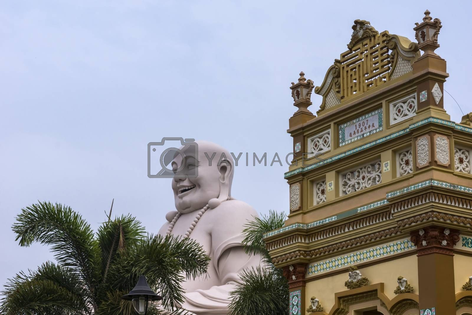 Royalty free image of Buddha head combined with top of Vinh Trang Pagoda, Vietnam. by Claudine