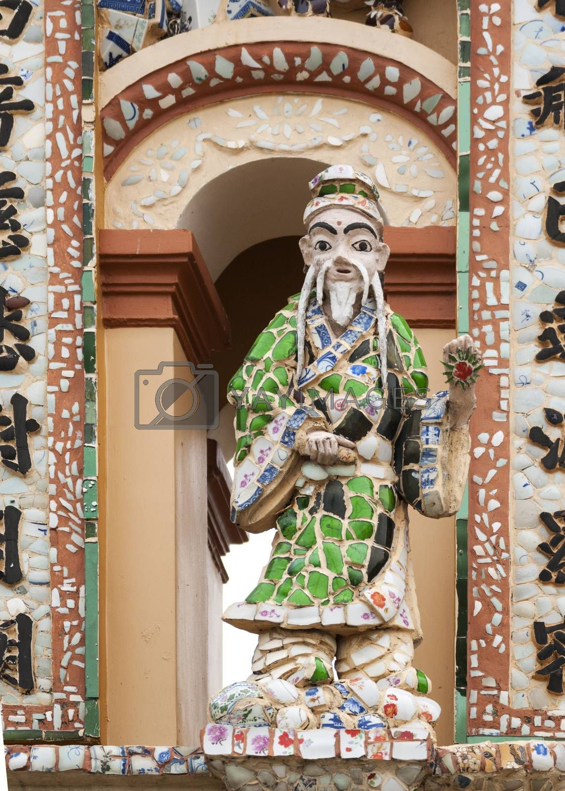 Royalty free image of Statue at gate to Buddhist Vinh Trang Pagoda, Vietnam. by Claudine
