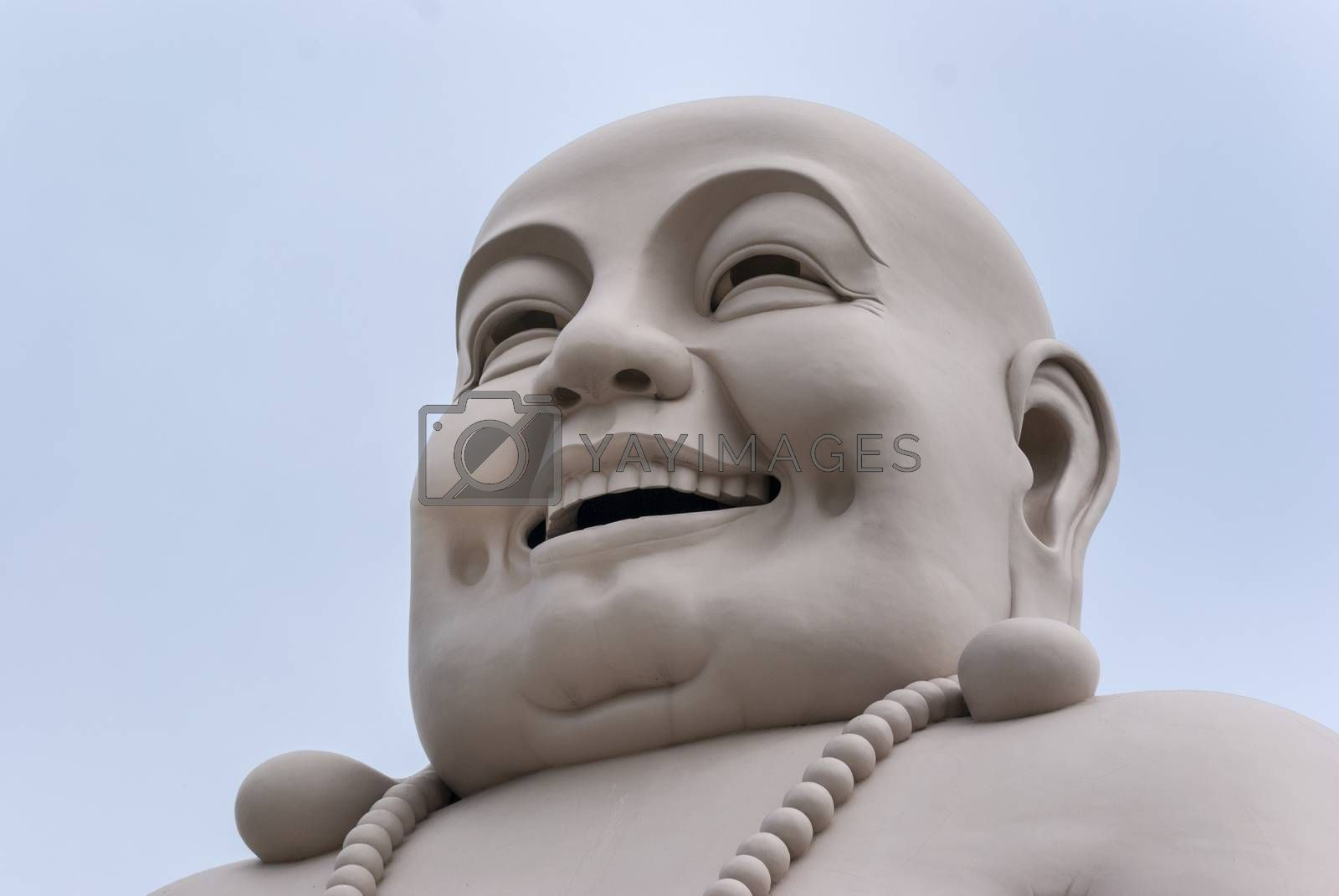 Royalty free image of Lateral view on Head of Massive White Buddha. by Claudine