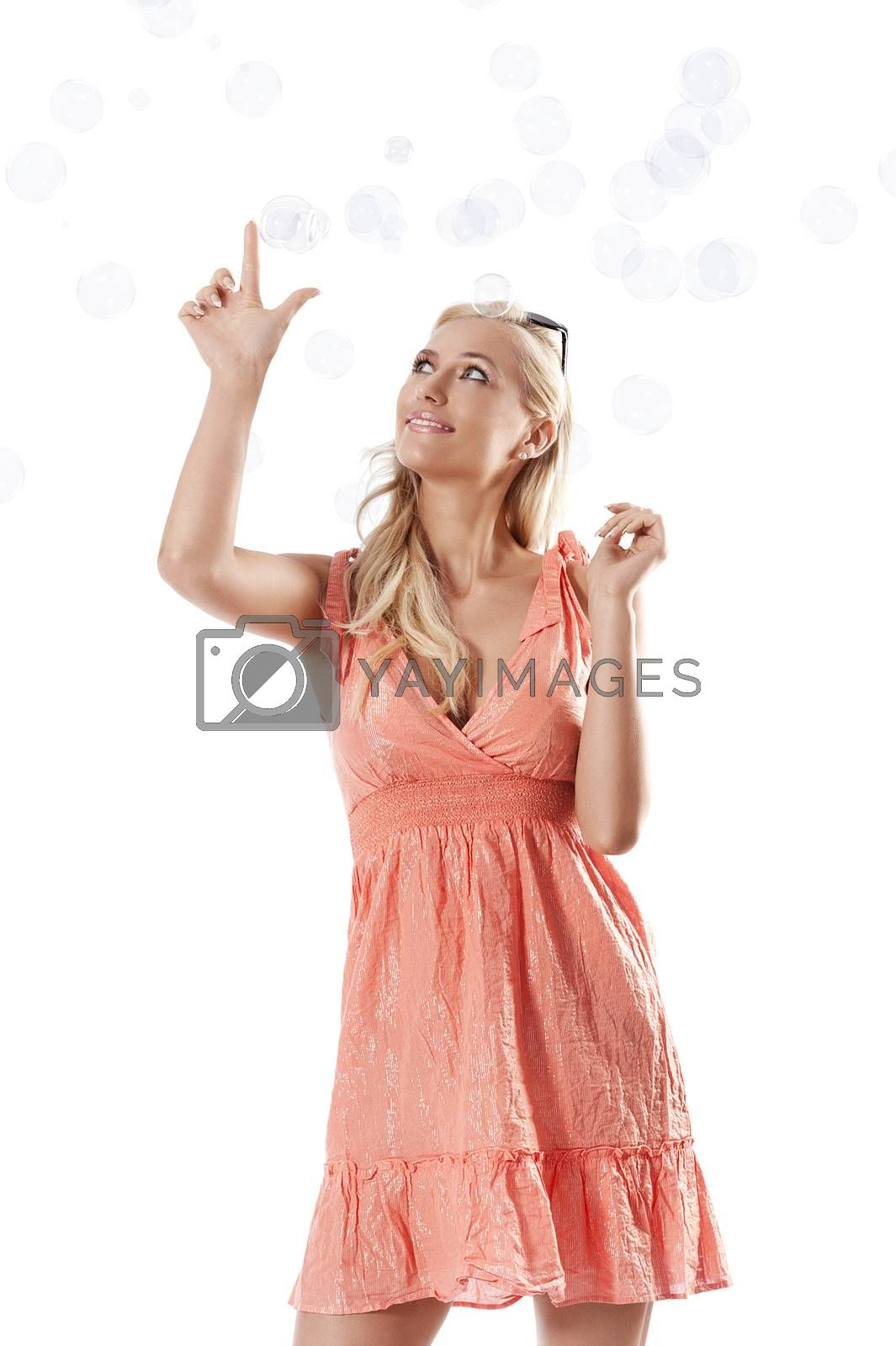 Royalty free image of blond beautiful girl playing against white background between so by fotoCD