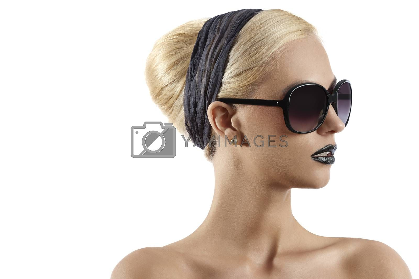 Royalty free image of fashion shot of blond girl with sunglasses against white backgro by fotoCD
