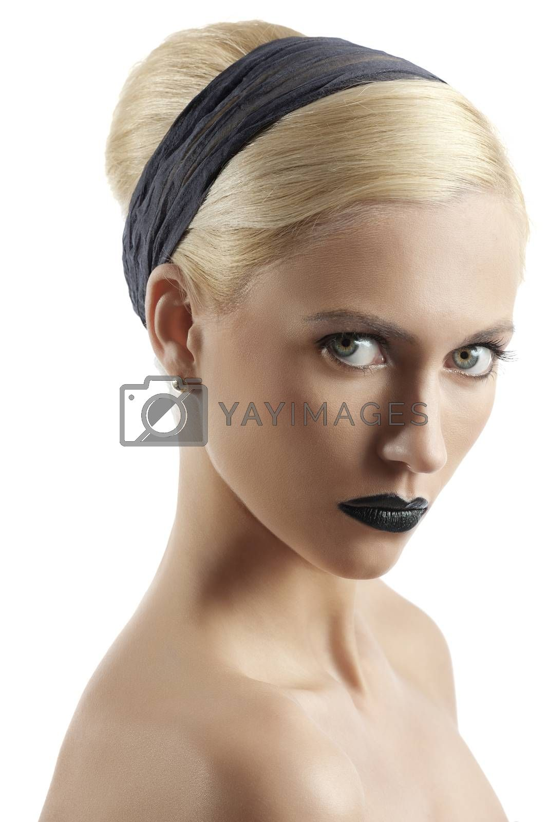 Royalty free image of fashion shot of blond girl with hair style looking at the camera by fotoCD