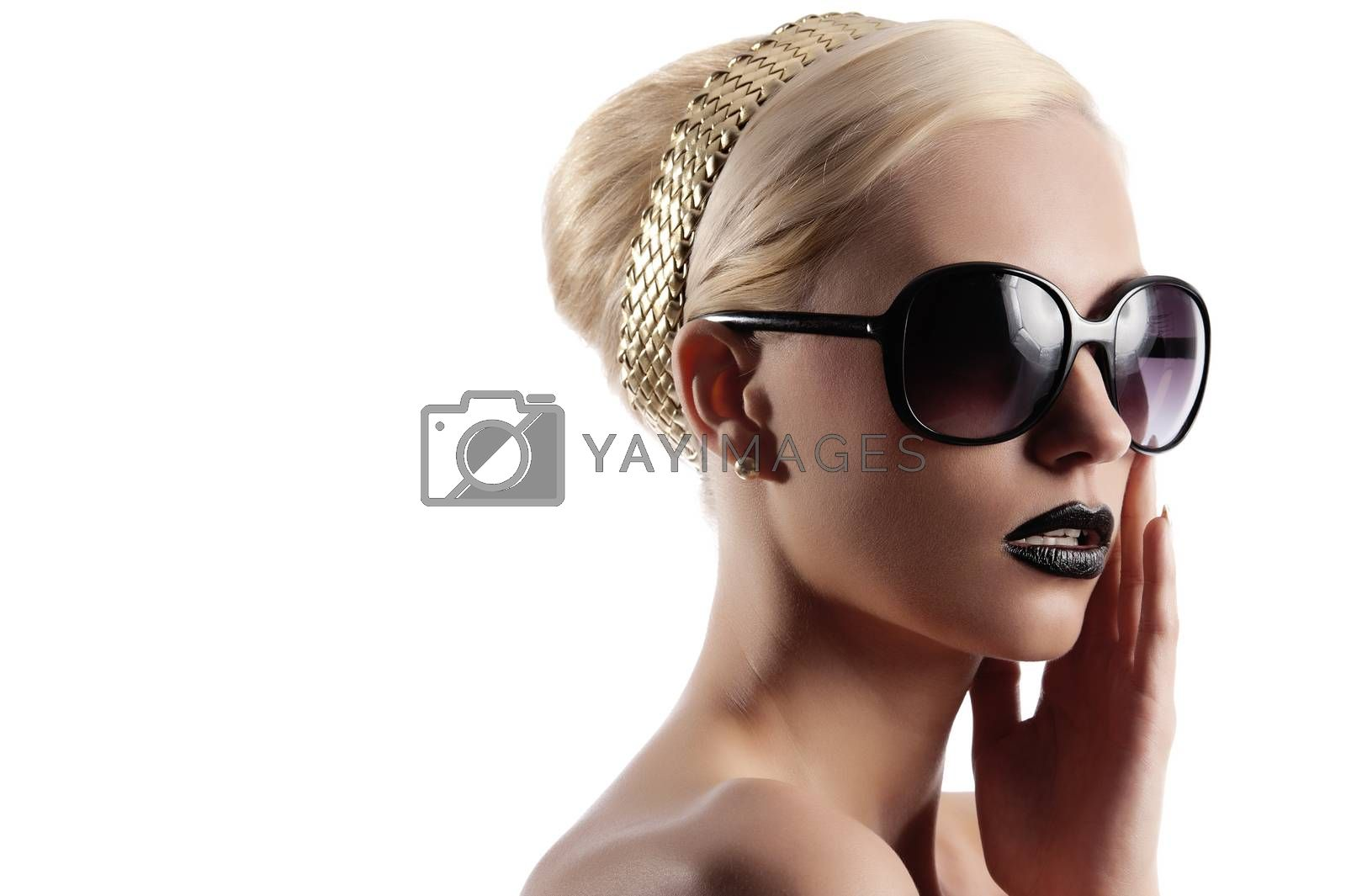 Royalty free image of blond girl with hair style by fotoCD