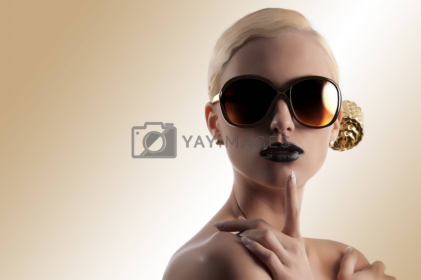 Royalty free image of fashion shot of blond girl with golden sunglasses by fotoCD