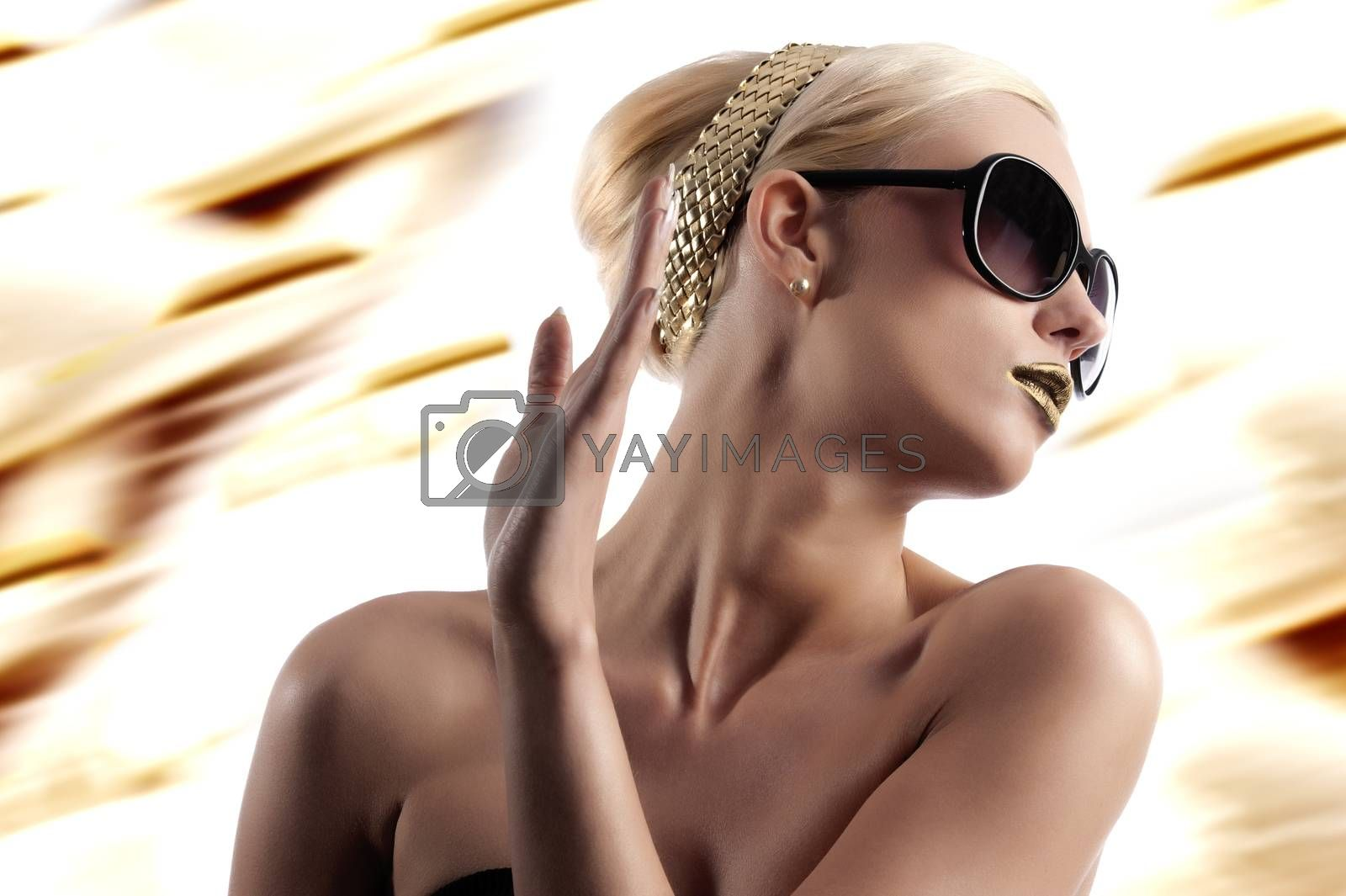 Royalty free image of fashion shot of blond woman with sunglasses by fotoCD