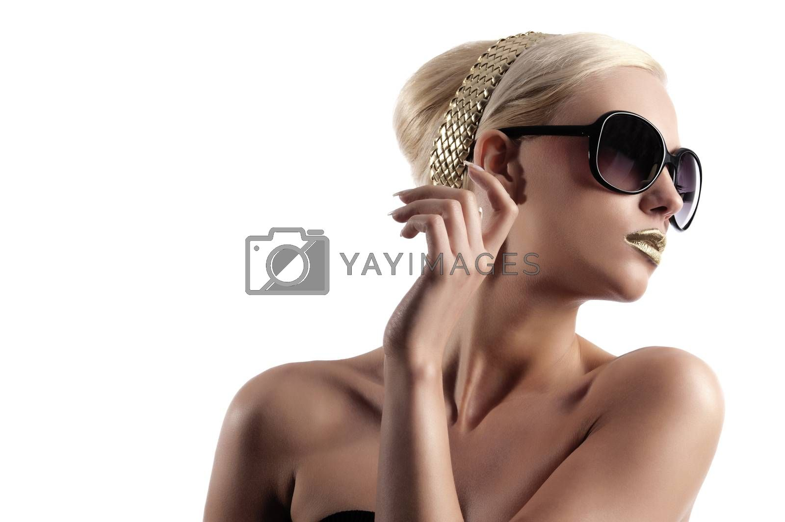 Royalty free image of fashion shot of blond woman with sunglasses on by fotoCD