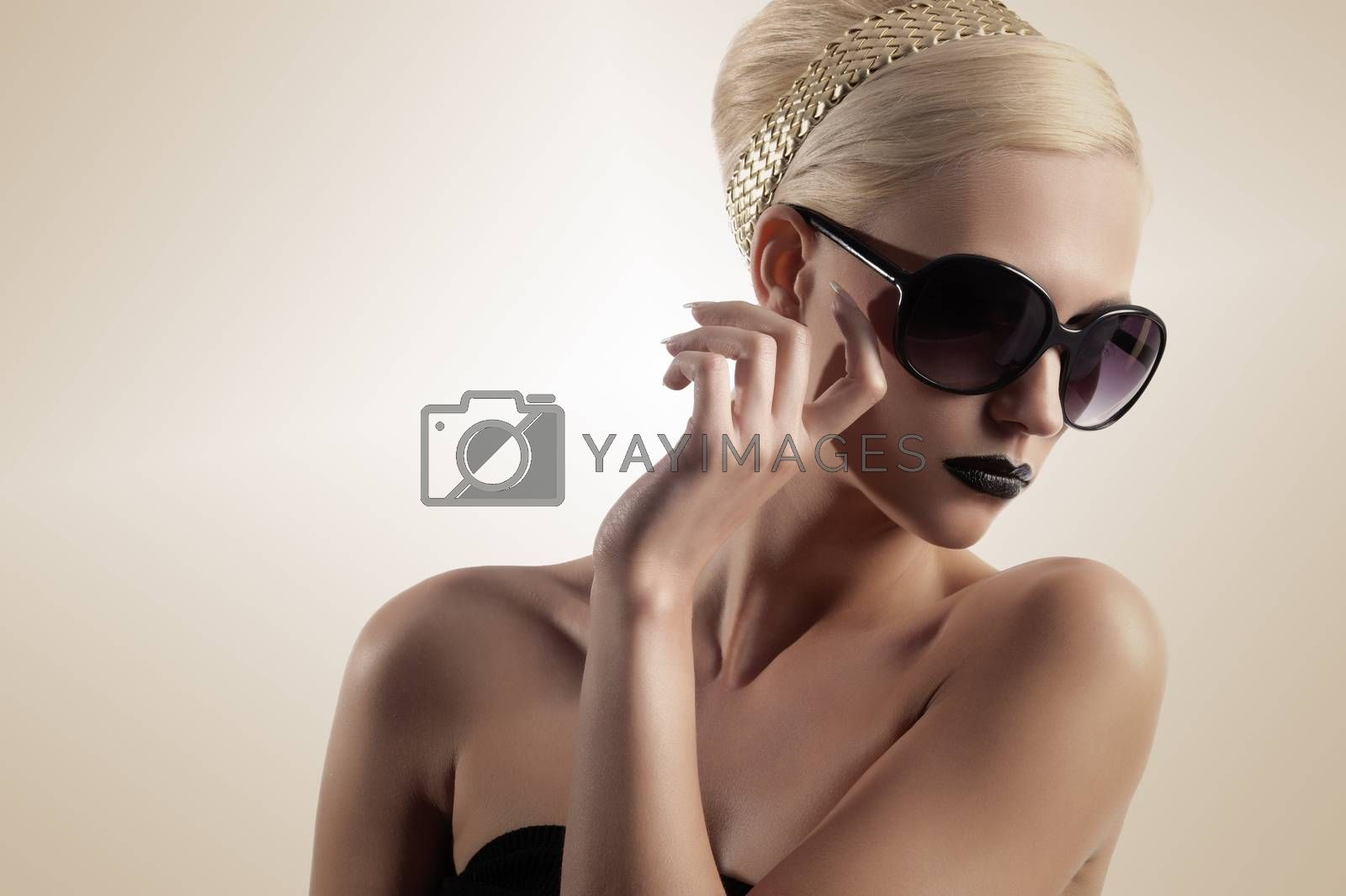 Royalty free image of blond girl with sunglasses by fotoCD