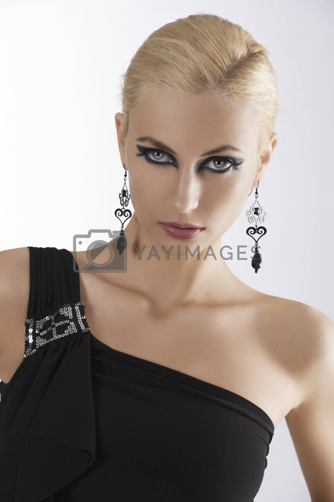 Royalty free image of portrait of blond girl in black dress by fotoCD