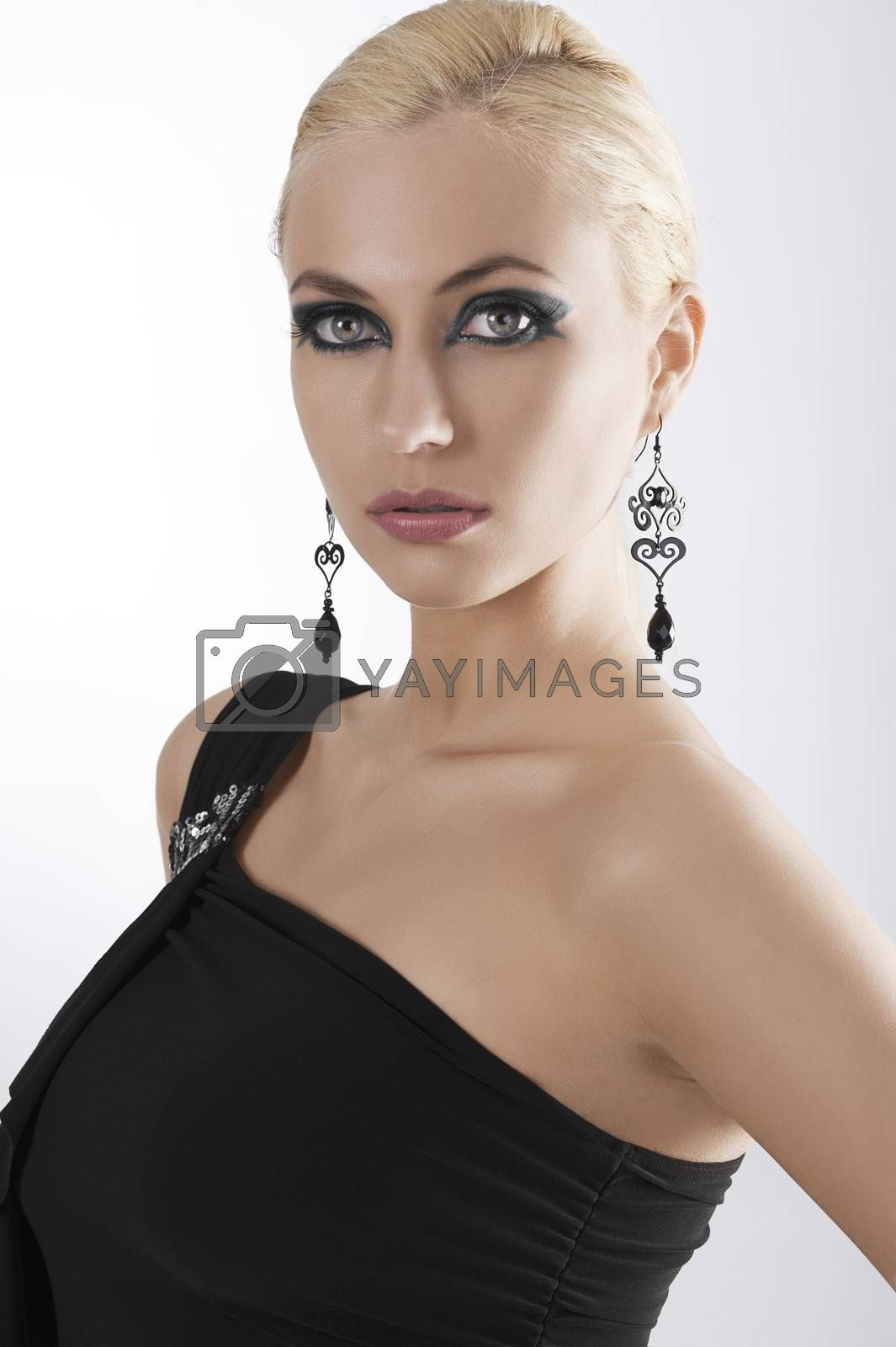 Royalty free image of portrait of blond girl in black dress posing by fotoCD